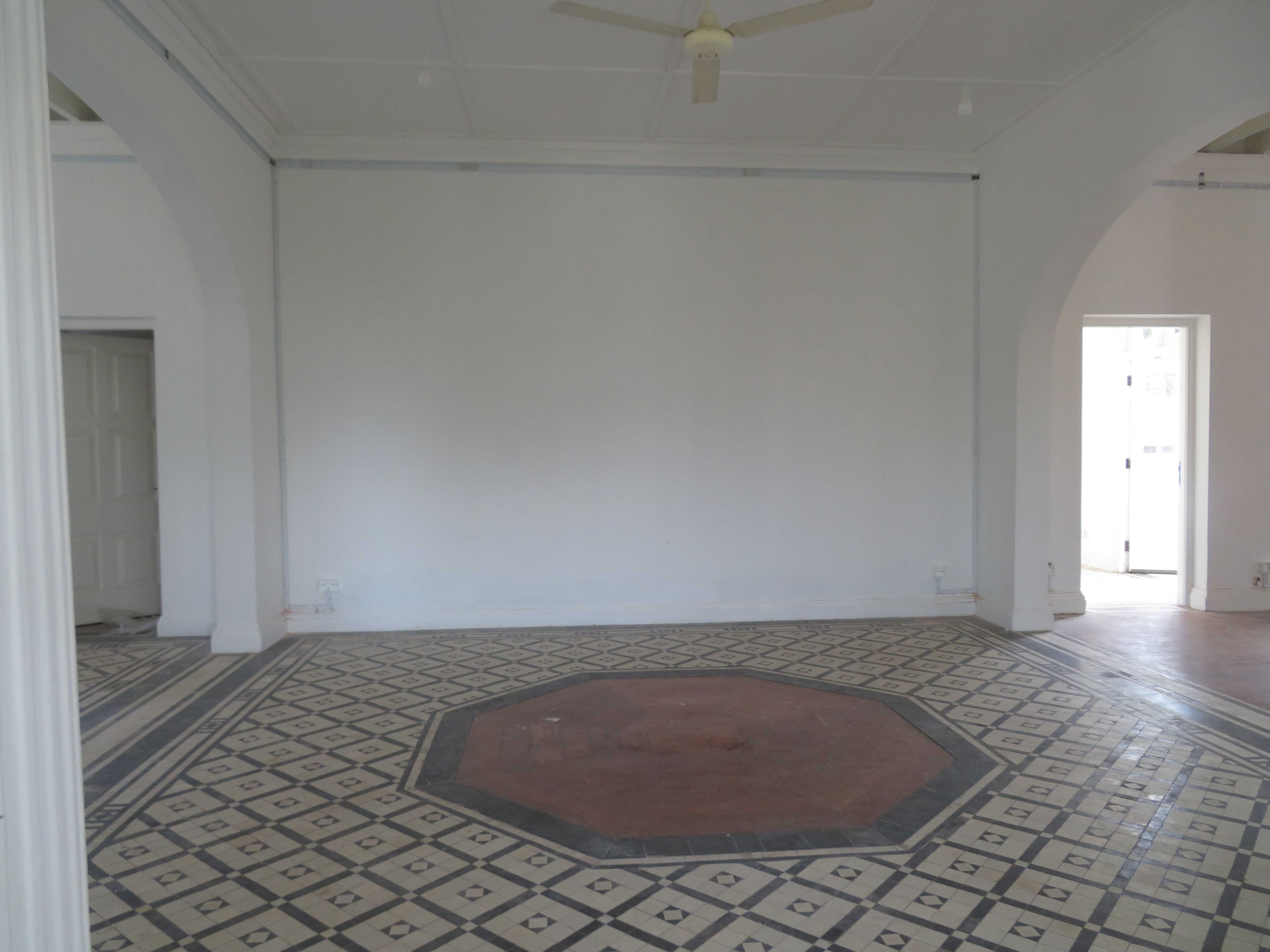 Timber architectural feature in the middle of tiled room
