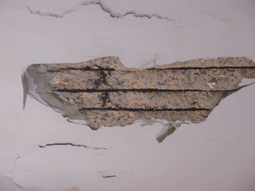 Spalling on ceiling with re-bar exposed