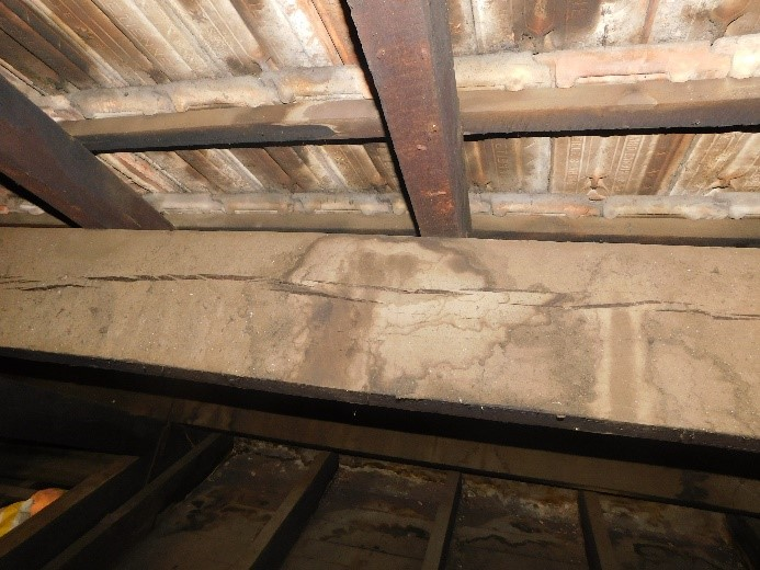 Damp marks and split on timber beam